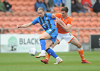 Gillingham's Tom Eaves under pressure from Blackpool's Ben Heneghan<br /> <br /> Photographer Kevin Barnes/CameraSport<br /> <br /> The EFL Sky Bet League One - Blackpool v Gillingham - Saturday 4th May 2019 - Bloomfield Road - Blackpool<br /> <br /> World Copyright © 2019 CameraSport. All rights reserved. 43 Linden Ave. Countesthorpe. Leicester. England. LE8 5PG - Tel: +44 (0) 116 277 4147 - admin@camerasport.com - www.camerasport.com