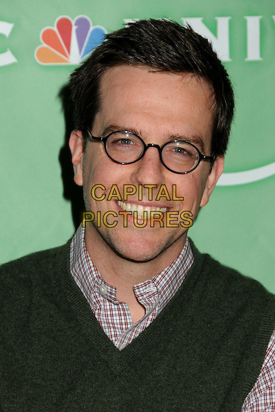 ED HELMS .NBC Universal Press Tour All-Star Party held at the Langham Huntington Hotel and Spa, Pasadena, California, USA, 13th January 2011..portrait headshot smiling  green sweater vest plaid shirt checked glasses .CAP/ADM/BP.©Byron Purvis/AdMedia/Capital Pictures.