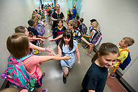 NWA Democrat-Gazette/JASON IVESTER<br /> Fourth-graders are congratulated by first-graders as they leave the school Friday, May 26, 2017, at Central Park Elementary School in Bentonville. Friday was the last day of the school year for Bentonville School District.