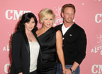 Shannen Doherty, Jennie Garth and Ian Ziering at Jennie Garth's 40th birthday celebration and premiere party for 'Jennie Garth: A Little Bit Country' at The London Hotel on April 19, 2012 in West Hollywood, California Credit: mpi35/MediaPunch Inc.