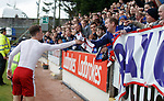 Andy Halliday hands his shirt to the fans