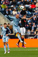 Aurelien Collin (78) of Sporting Kansas City goes up for a header with Sebastien Le Toux (11) of the Philadelphia Unionduring a Major League Soccer (MLS) match at PPL Park in Chester, PA, on March 2, 2013.