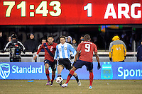 Javier Zanetti (8) of Argentina plays the ball between Clint Dempsey (8) and Juan Agudelo (9) of the United States. The United States (USA) and Argentina (ARG) played to a 1-1 tie during an international friendly at the New Meadowlands Stadium in East Rutherford, NJ, on March 26, 2011.