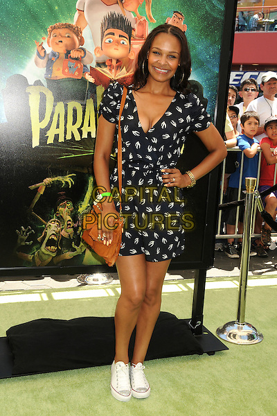 "Samantha Mumba .""ParaNorman"" Los Angeles Premiere held at AMC CityWalk Stadium 19 Theatre, Universal City, California, USA..August 5th, 2012.full length white black print dress brown satchel sneakers trainers hand on hip cleavage  birds swallows .CAP/ADM/BP.©Byron Purvis/AdMedia/Capital Pictures."