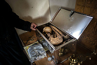 Mount Athos - The Holy Mountain.<br /> Bones belonging to the monk who previously lived at that cell is kept in a silver box. Even after death, the monk remains in the cell.<br /> <br /> Photographer: Rick Findler