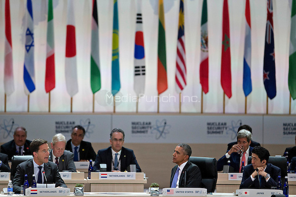 United States President Barack Obama, center, and Shinzo Abe, Japan's prime minister, right, listen as Mark Rutte, Dutch prime minister, speaks during an opening plenary entitled &quot;National Actions to Enhance Nuclear Security&quot; at the Nuclear Security Summit in Washington, D.C., U.S., on Friday, April 1, 2016. After a spate of terrorist attacks from Europe to Africa, Obama is rallying international support during the summit for an effort to keep Islamic State and similar groups from obtaining nuclear material and other weapons of mass destruction. <br /> Credit: Andrew Harrer / Pool via CNP/MediaPunch