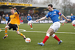 Captain for the day Lee Wallace swings a cross into the box
