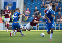 Ben Stevenson of Colchester United catches Harry Smith of Northampton Town and concedes a free kick during Colchester United vs Northampton Town, Sky Bet EFL League 2 Football at the JobServe Community Stadium on 24th August 2019