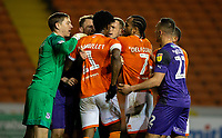Blackpool's Armand Gnanduillet has angry words with Tranmere Rovers' Mark Ellis and Peter Clarke<br /> <br /> Photographer Alex Dodd/CameraSport<br /> <br /> The EFL Sky Bet League One - Blackpool v Tranmere Rovers - Tuesday 10th March 2020 - Bloomfield Road - Blackpool<br /> <br /> World Copyright © 2020 CameraSport. All rights reserved. 43 Linden Ave. Countesthorpe. Leicester. England. LE8 5PG - Tel: +44 (0) 116 277 4147 - admin@camerasport.com - www.camerasport.com