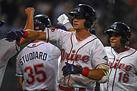 Third baseman Bobby Dalbec (23) of the Greenville Drive is congratulated after hitting a three-run home run in the eighth inning of Game 3 of the South Atlantic League Southern Division Playoff against the Charleston RiverDogs on Saturday, September 9, 2017, at Fluor Field at the West End in Greenville, South Carolina. Greenville won, 5-0, winning the division championship two games to one. (Tom Priddy/Four Seam Images)