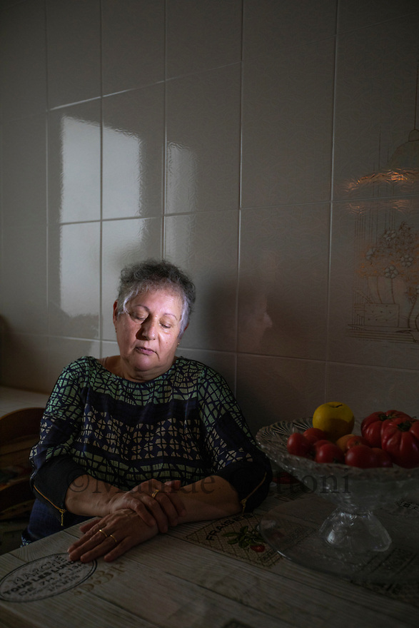 """Spain - Argentona - Portrait of Ana Paez Garro, 62. In 1981 Paez Garro was living in Mataró, a placid seaside town 30 kilometres outside Barcelona, and her couple was wealthy enough to trade the old local hospital for the brand-new, state-of-the-art maternity of the Vall d'Hebron health complex, in Barcelona. Thirty years later, it would be exposed as one of the clinics most connected with the niños robados scandal. Paez Garro entered the hospital on the 9th of July and was put in a ward with other premature mothers. She was 30-week-pregnant, and was given treatment to delay labour for two days. """"there's no better incubator than a mother"""", nurses were telling her. At 1am on the third night, a doctor suddenly instructed them to prepare the mother for immediate delivery. <br /> The young woman was brought to a small room on a lower floor, where a doctor and two women who appeared to be in their 40s - Paez Garro assumed they were midwives - were waiting for her.  As soon as the baby's head came out, the mother heard one of the two saying """"I don't like these eyes"""". The doctor and the women left the room together with the baby immediately after the delivery. Paez Garro didn't see her baby, but she heard him groaning. <br /> <br /> The mother was left alone in the room, baffled and bleeding profusely, until the doctor came back a while later. """"It happens once every hundred times, but it happened to you"""", he only told her. A few hours later, the rest of the family was informed that the baby had been born dead and poli-malformed. Paez Garro's husband and mother wanted to see the corpse, but were eventually persuaded to desist, since the baby was apparently in such a bad state that his sight could mark their memories forever. Paez was eventually moved to a communal room with four new mothers, where she stayed for five more days. """"It was a daily torture"""", she recounts. """"Nurses were passing three times a day to change diapers. They used to knock on the glass and"""