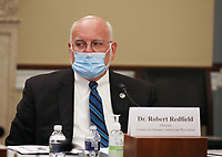 """Dr. Robert Redfield, Director of the Centers for Disease Control and Prevention waits to testify when the United States House Labor, Health and Human Services, Education and Related Agencies Subcommittee holds a hearing on """"COVID-19 Response on Capitol Hill in Washington, DC on Thursday, June 4, 2020. <br /> Credit: Tasos Katopodis / Pool via CNP/AdMedia"""