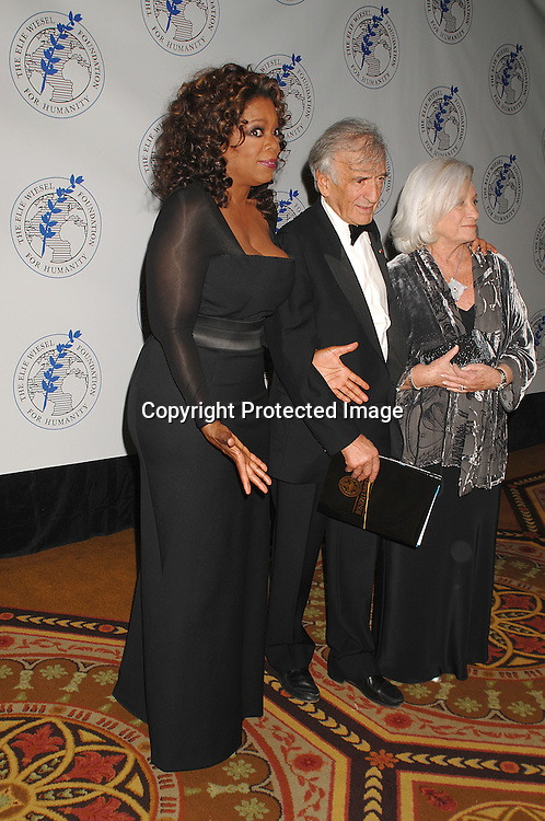 Oprah Winfrey and Elie Wiesel and wife Marion..posing for photos at The Elie Wiesel Foundation for Humanity Award Dinner honoring Oprah Winfrey on ..May 20, 2007 at The Waldorf Astoria Hotel. ..Robin Platzer, Twin Images........212-935-0770