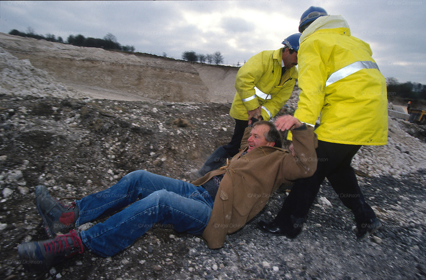 Dr David Abbot a local protester manhandled by security at the Cutting. Road Protest actions at Twyford Down, near the Donga pathways, outside Winchester, against the M3 road extension. 1992-94<br />