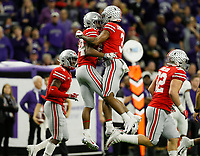 Ohio State Buckeyes cornerback Damon Arnette Jr. (3) congratulates cornerback Shaun Wade (24) after he intercepted a pass during the second quarter of the Big Ten Championship against the Northwestern Wildcats at Lucas Oil Stadium in Indianapolis on Dec. 1, 2018. [Adam Cairns/Dispatch]