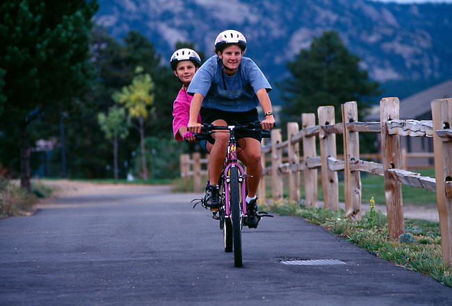 A mother and daughter enjoy a tandem bike ride in Estes Park, CO