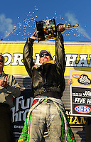 Nov. 11, 2012; Pomona, CA, USA: NHRA funny car driver Jack Beckman celebrates after clinching the 2012 championship during the Auto Club Finals at at Auto Club Raceway at Pomona. Mandatory Credit: Mark J. Rebilas-