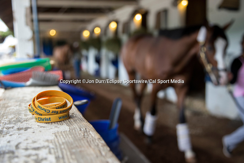 "Rubberband bracelets that read ""Horsemen for Christ,"" which is used to promote the chapel at Churchill Downs lay in a barn in Louisville, Ky. on April 30, 2014."