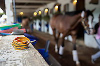 """Rubberband bracelets that read """"Horsemen for Christ,"""" which is used to promote the chapel at Churchill Downs lay in a barn in Louisville, Ky. on April 30, 2014."""