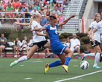 In a National Women's Soccer League Elite (NWSL) match, Portland Thorns FC defeated the Boston Breakers, 2-1, at Dilboy Stadium on July 21, 2013.  Boston Breakers forward Lianne Sanderson (10) kicks the first goal as Portland Thorns FC defender Kathryn Williamson (5) tackles.