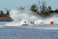 Frame 11: Terry Rinker (#10) and Chris Fairchild (#62) race up the back stright to turn 2 where Rinker's boat rolls over a wake, noses in and flips.   (Formula 1/F1/Champ class)