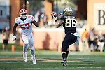 Wake Forest Demon Deacons tight end Jack Freudenthal (86) catches  pass in front of Clemson Tigers linebacker Tre Lamar (57) during first half action at BB&T Field on October 6, 2018 in Winston-Salem, North Carolina. (Brian Westerholt/Sports On Film)
