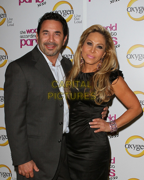 "DR. PAUL NASSIF & ADRIENNE MALOOF.""The World According To Paris"" Series Premiere Party  Held At The Roosevelt Hotel, Hollywood, California, USA, .17th May 2011..half length couple husband wife dress black blue shirt grey gray hand on hip dress suit .CAP/ADM/KB.©Kevan Brooks/AdMedia/Capital Pictures."
