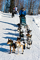 Tom Lesatz arrives at the Galena checkpoint and runs down to the corralling area where other teams are resting during the 2010 Iditarod