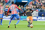 Atletico de Madrid's Thomas Teye and Valencia CF's Carlos Soler during La Liga match between Atletico de Madrid and Valencia CF at Vicente Calderon Stadium  in Madrid, Spain. March 05, 2017. (ALTERPHOTOS/BorjaB.Hojas)