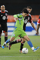 Seattle Sounders forward Freddy Montero (17) shields the ball against D.C. United midfielder Perry Kitchen (23)  D.C. United tied the Seattle Sounders, 0-0 at RFK Stadium, Saturday April 7, 2012.