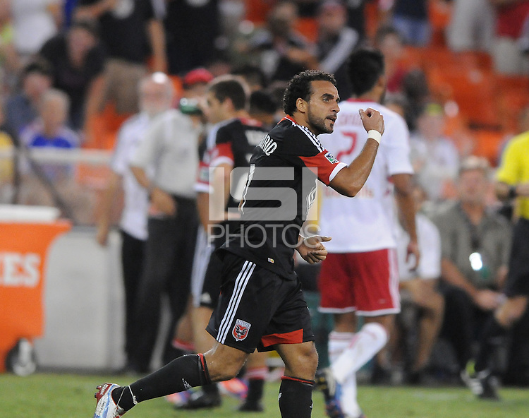 D.C. United forward Dwayne De Rosario (7) celebrates his 100th goal.  The New York Red Bulls tied D.C. United 2-2 at RFK Stadium, Wednesday August 29, 2012.