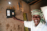 Elizabeth Mukwimba is a 62-year-old Tanzanian woman who now has solar lighting and electricity in her home at the flick of a switch, thanks to a scheme backed by UK aid.<br /> <br /> Elizabeth has had an M-Power solar panel and lights fitted in her home by Off Grid Electric, a private sector company dedicated to providing sustainable, affordable energy to people in developing countries who aren't connected to the electricity grid. <br /> <br /> It means that Elizabeth now has lighting at home at night, which means she doesn't have to buy expensive kerosene. The money she's saved already has helped her put a new tin roof on her house. It also means her grandchildren can read and do their homework in the evening.<br /> <br /> UK aid is providing support to help Off Grid Electric expand its business to reach more and more people who live in remote, rural areas, through two international partnership programmes - Energising Development (EnDev), and the Africa Enterprise Challenge Fund Renewable Energy and Adaptation to Climate Technologies (AECF REACT).<br /> <br /> The UK's support to EnDev is a 'results based financing' facility - this provides a financial incentive for companies like Off Grid - meaning they only get access to finance if they meet a given target (increasing the number of people who have access to clean energy) over a fixed period of time. This acts to boost the market returns for private sector companies providing services to poorer consumers, thereby attracting investment and enabling continued market expansion after the project (and financial incentive) ends.<br /> <br /> In less than 2 years, Off Grid Electric has installed solar power systems in over 22,000 homes across Tanzania, meaning many more people now have access to cheap, renewable electricity - a vital step forward in a country where less than 14% of the population are connected to the electricity grid.<br /> <br /> Picture: Russell Watkins/Department for International Development