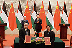 Palestinian Foreign Minister Riyad Al-Maliki attends a signing ceremony with Chinese Foreign Minister Wang Yi as Palestinian President Mahmoud Abbas and Chinese President Xi Jinping applaud at the Great Hall of the People in Beijing on July 18, 2017. Abbas is on an official visit to China from July 17-20. Photo by Thaer Ganaim