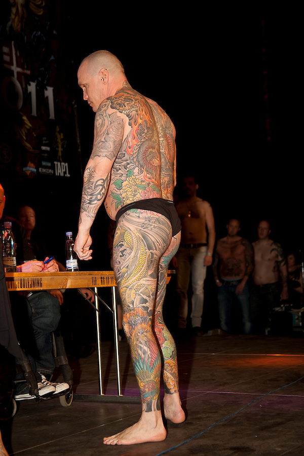 Snapshots from the Ink Festival in Copenhagen April 2011. Tree days of tattoo, tattooing and shows. The contest for large tattoos.