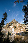 A peak is reflected in Twin Lakes in the Sawtooth Wilderness of Idaho.