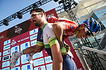 Race leader Red Jersey Esteban Chaves (COL) Orica GreenEdge gets a lift from his teammate to sign on before the start of Stage 4, The Yas Stage, of the 2015 Abu Dhabi Tour running 110 km 20 laps around the Yas Marina Circuit, Abu Dhabi. 11th October 2015.<br /> Picture: ANSA/Claudio Peri | Newsfile