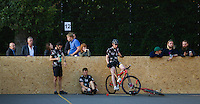 17 AUG 2014 - LONDON, GBR - Triple Jay players rest before the final against Mondial at the 2014 London Open bike polo tournament in Highbury Fields in London, Great Britain (PHOTO COPYRIGHT © 2014 NIGEL FARROW, ALL RIGHTS RESERVED)