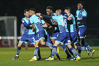 Scott Kashket of Wycombe Wanderers celebrates with team mates after he scores the opening goal of the game during the Sky Bet League 2 match between Wycombe Wanderers and Leyton Orient at Adams Park, High Wycombe, England on 17 December 2016. Photo by David Horn / PRiME Media Images.