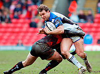 Olly Barkley is tackled hard around the waist. Guinness Premiership match between Saracens and Bath on February 28, 2010 at Vicarage Road in Watford, England. [Mandatory Credit: Patrick Khachfe/Onside Images]