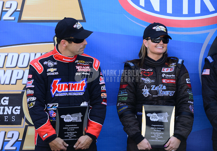 Sept. 14, 2012; Concord, NC, USA: NHRA pro stock driver Greg Anderson (left) with Erica Enders during qualifying for the O'Reilly Auto Parts Nationals at zMax Dragway. Mandatory Credit: Mark J. Rebilas-