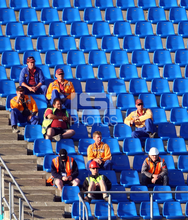 Road workers call in to watch the game..FIFA U17 Women's World Cup, Semi Final, Germany v USA, QEII Stadium, Christchurch, New Zealand, Thursday 13 November 2008. Photo: Renee McKay/PHOTOSPORT