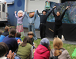 """Members of Arm-of-the-Sea Theater, Laura Rock Kopczak, Anna Hoffner, Patrick Wadden and Soyal Smalls, acknowledging the audiences appreciation at the end of the presentation of their new play """"DIRT"""" that tells the story of how Garlic came to the area, at the 27th Annual Hudson Valley Garlic Festival, held in Cantine Memorial Field, in Saugerties, NY, on Saturday, October 1, 2016. Photo by Jim Peppler; Copyright Jim Peppler 2016."""