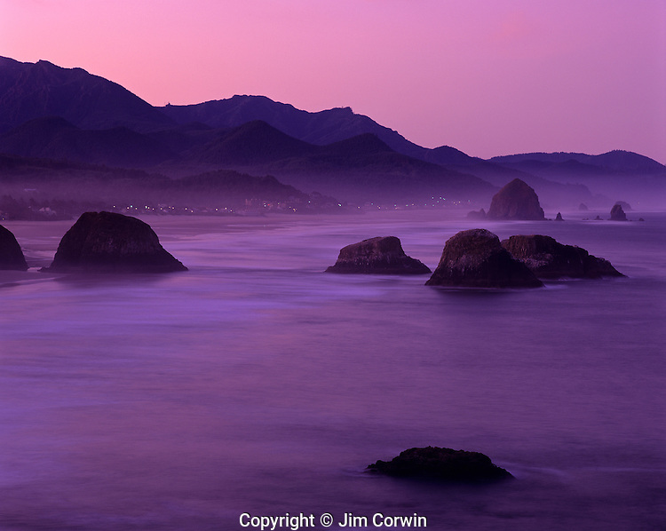 Northern Oregon Coast Ecola State Park sunrise light with beach rock formations looking south toward Cannon Beach Oregon State USA