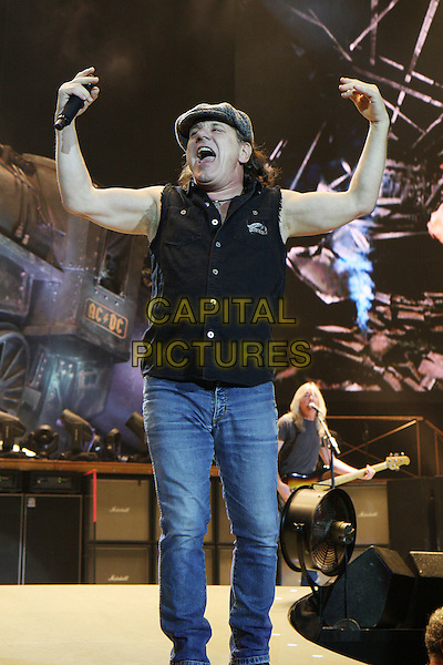 AC/DC - Brian Johnson .Performing live at the O2 Arena, London, England..April 16th, 2009.AC / AC ACDC stage ceoncert gig music performance full length jeans denim black hat top arms outstretched mouth open.CAP/MAR.© Martin Harris/Capital Pictures.