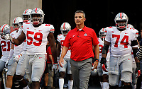 Ohio State Buckeyes defensive lineman Tyquan Lewis (59), Ohio State Buckeyes head coach Urban Meyer and Ohio State Buckeyes offensive lineman Jamarco Jones (74) wait to take the field before their game against Indiana Hoosiers  at Memorial Stadium in Bloomington, IN on August 31, 2017.  [Kyle Robertson/Dispatch]
