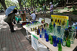 Vases and other objects made from recycled bottles are displayed at a store at the Art Marker inside Inokashira Park in the trendy neighborhood of Kichijoji in Musashino City,  Tokyo, Japan on 16 Sept. 2012.  Photographer: Robert Gilhooly