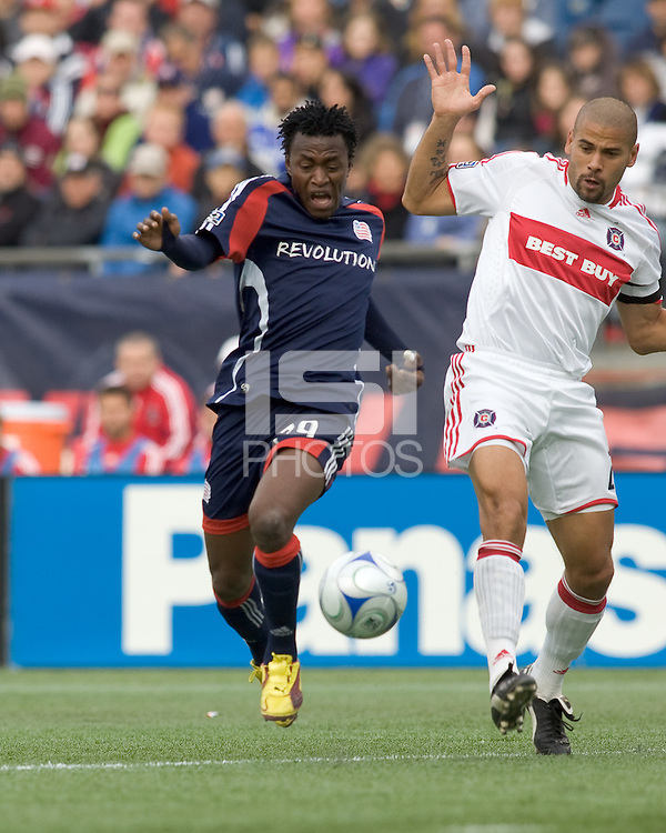 New England Revolution forward/midfielder Kenny Mansally (29) and Chicago Fire defender C.J. Brown (2) chase down loose ball. The New England Revolution out scored the Chicago Fire, 2-1, in Game 1 of the Eastern Conference Semifinal Series at Gillette Stadium on November 1, 2009.