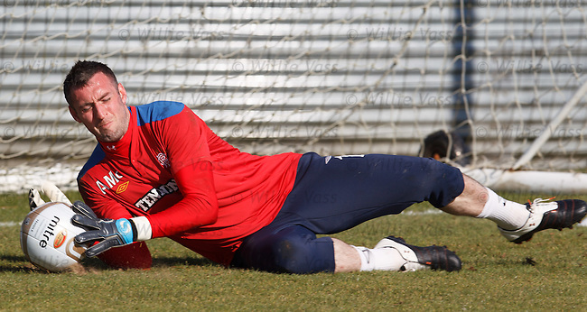 Allan McGregor gets down to save at training