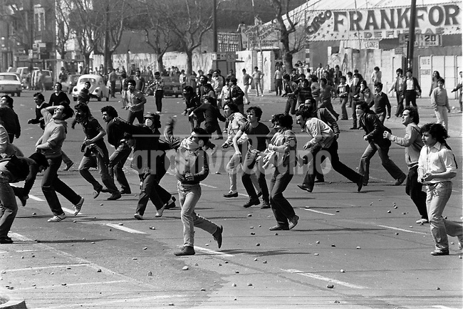 Jovenes se enfrentan con la policia en la quinta protesta contra la dictadura.<br /> Santiago Chile Septiembre 1983<br /> <br /> Forty years ago, on September 11, 1973, a military coup led by General Augusto Pinochet toppled the democratic socialist government of Chile. President Salvador Allende was killed during the  attack to seize  La Moneda presidential palace.  In the aftermath of the coup, a quarter of a million people were detained for their political beliefs, 3000 were killed or disappeared and many thousands were tortured.<br /> Some years later in 1981, while Pinochet ruled Chile with iron fist, a young photographer called Juan Carlos Caceres started to freelance in the streets of Santiago and the poblaciones or poor outskirts, showing the growing resistance against the dictatorship. For the next 10 years Caceres photographed every single protest and social movement fighting for the restoration of democracy. He knew that his camera was his only weapon, he knew that his fate was to register the daily violence and leave his images for the History.<br /> In this days Caceres is working to rescue and organize his collection of images in the project Imagenes de la Resistencia   . With support of some Chilean official institutions, thousands of negatives are digitalized and organized to set up the more complete visual heritage of this  violent period of Chile&acute;s history.