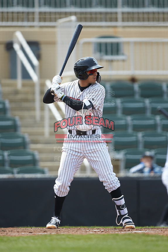 Laz Rivera (13) of the Kannapolis Intimidators at bat against the Lakewood BlueClaws at Kannapolis Intimidators Stadium on April 8, 2018 in Kannapolis, North Carolina.  The Intimidators defeated the BlueClaws 5-1 in game one of a double-header.  (Brian Westerholt/Four Seam Images)